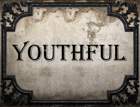youthful: youthful word on concrete wall Stock Photo