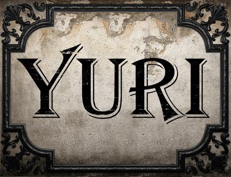 yuri: yuri word on concrete wall Stock Photo