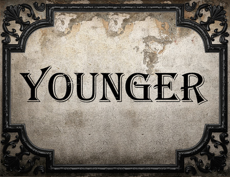 younger: younger word on concrete wall