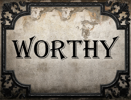 worthy: worthy word on concrete wall Stock Photo