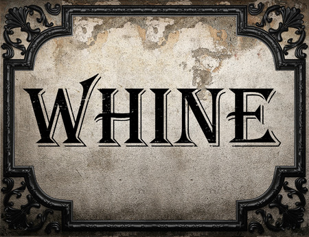 whine: whine word on concrete wall Stock Photo