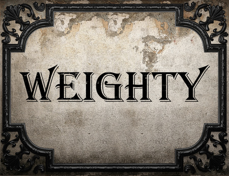 weighty: weighty word on concrete wall Stock Photo