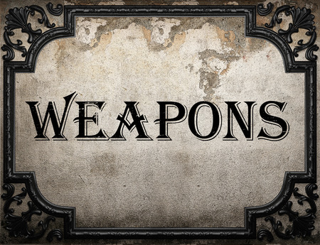 weapons: weapons word on concrete wall