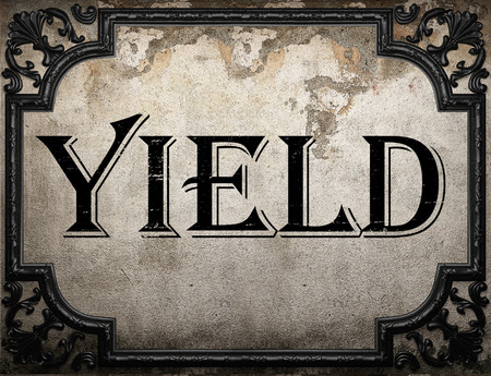 yield: yield word on concrete wall Stock Photo
