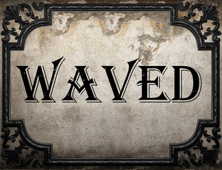 waved: waved word on concrete wall