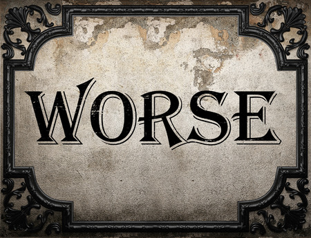 worse: worse word on concrete wall Stock Photo