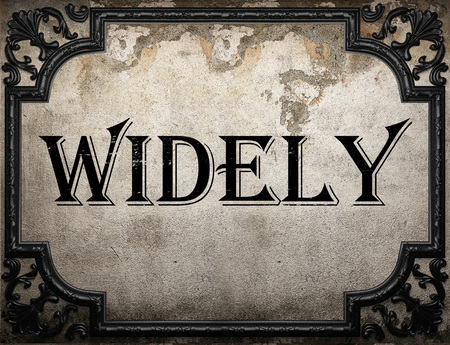 widely: widely word on concrete wall
