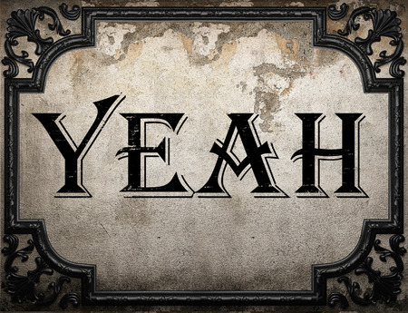 yeah: yeah word on concrete wall