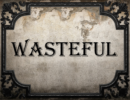 wasteful: wasteful word on concrete wall Stock Photo