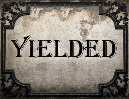 yielded: yielded word on concrete wall