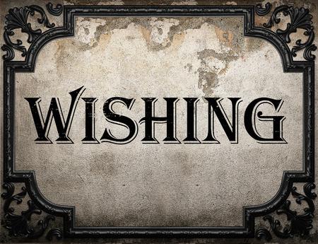 wishing: wishing word on concrete wall Stock Photo