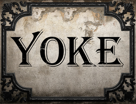 yoke: yoke word on concrete wall Stock Photo
