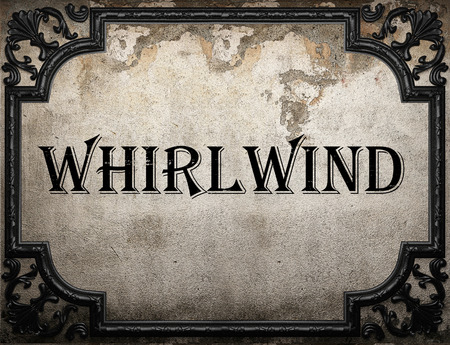 whirlwind: whirlwind word on concrete wall