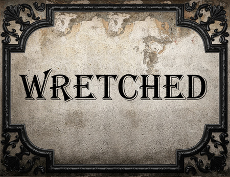 wretched: wretched word on concrete wall Stock Photo