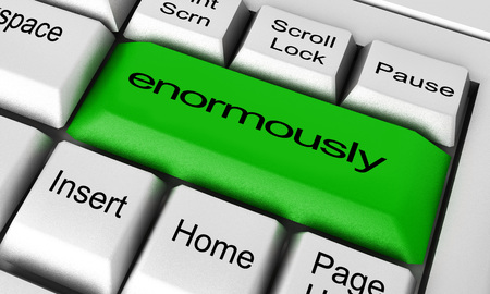 enormously: enormously word on keyboard button