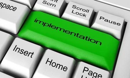 implementatie woord op het toetsenbord knop Stockfoto