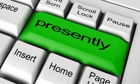 presently: presently word on keyboard button Stock Photo