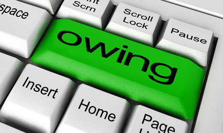 owing: owing word on keyboard button