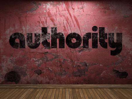 autoridad: palabra autoridad en la pared roja