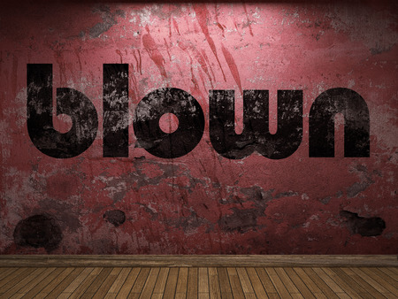 blown: blown word on red wall