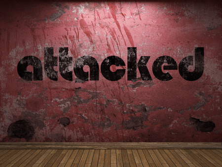 attacked: attacked word on red wall