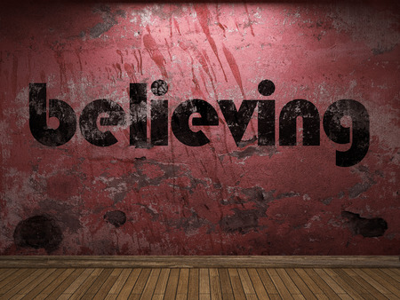 believing: believing word on red wall