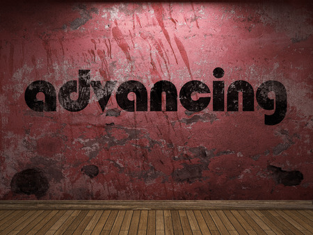 advancing: advancing word on red wall Stock Photo
