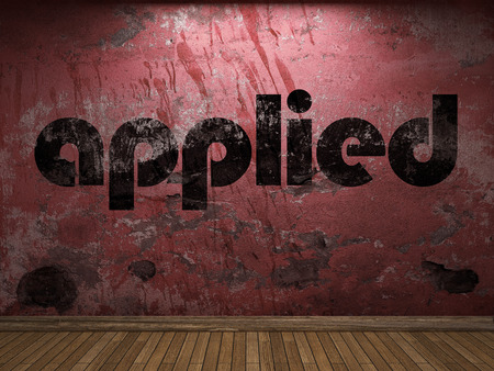 applied: applied word on red wall