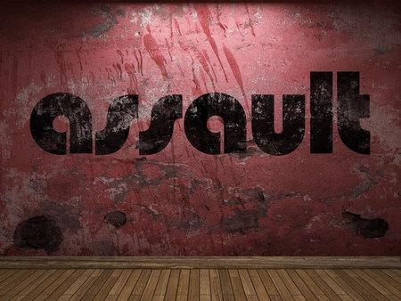 assault: assault word on red wall Stock Photo