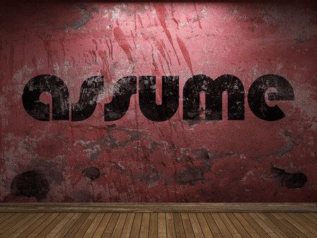 assume: assume word on red wall Stock Photo