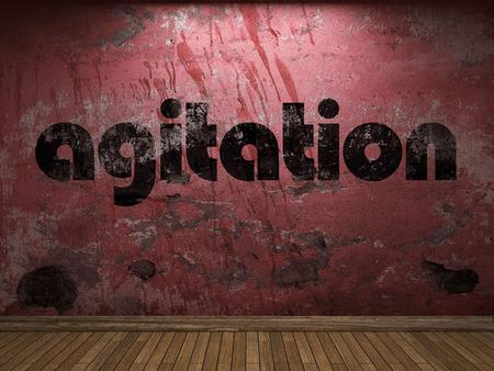 agitation: agitation word on red wall Stock Photo