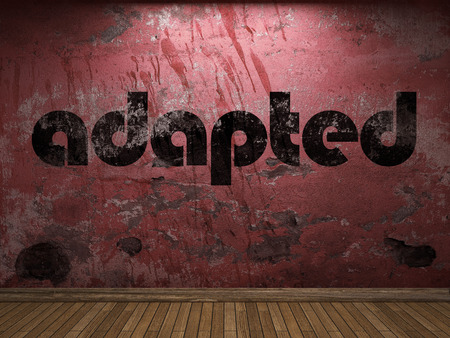 adapted: adapted word on red wall