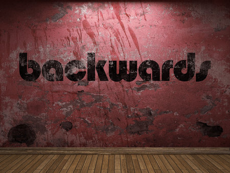 backwards: backwards word on red wall Stock Photo