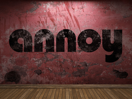 annoy: annoy word on red wall Stock Photo