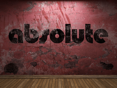 absolute: absolute word on red wall Stock Photo