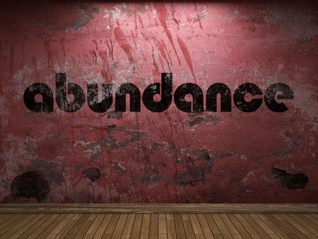 abundance word on red wall