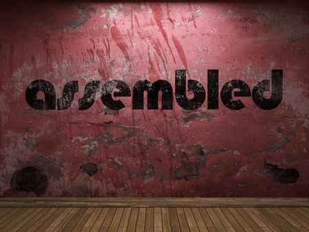assembled: assembled word on red wall Stock Photo