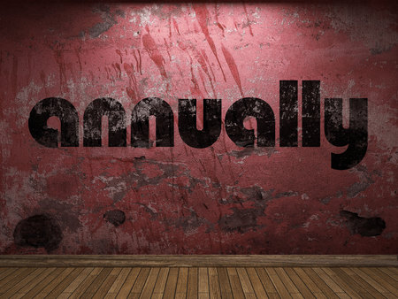 annually: annually word on red wall Stock Photo