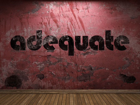 adequate: adequate word on red wall Stock Photo