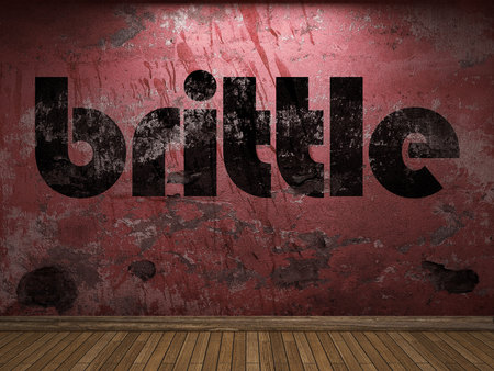 brittle: brittle word on red wall
