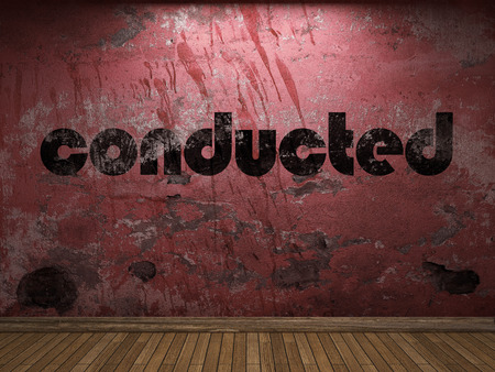 conducted: conducted word on red wall