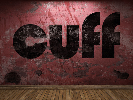 cuff: cuff word on red wall Stock Photo