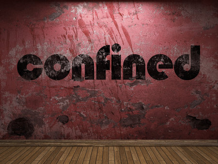 confined: confined word on red wall Stock Photo