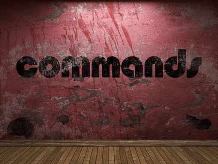 commands: commands word on red wall Stock Photo