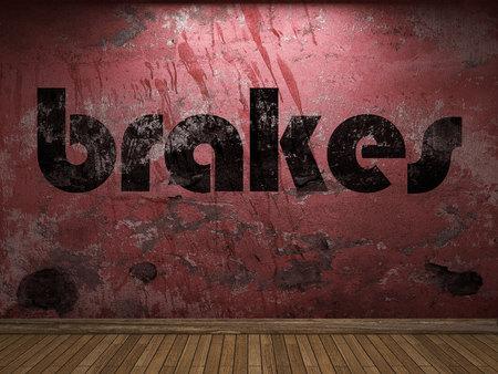 frenos: frenos de palabra en la pared roja Foto de archivo