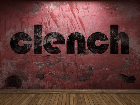 clench: clench word on red wall Stock Photo
