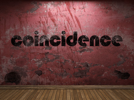 coincidence: coincidence word on red wall Stock Photo