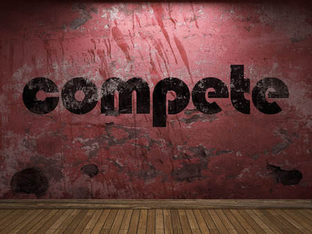 compete: compete word on red wall Stock Photo