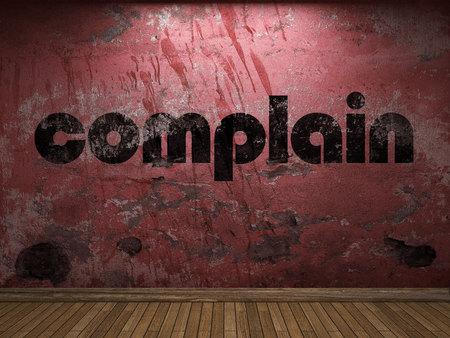 complain: complain word on red wall