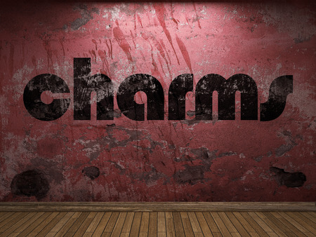 charms: charms word on red wall Stock Photo